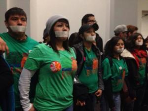 Youth from the community group Juntos demonstrate inside the School District of Philadelphia during the session of the School Reform Commission.